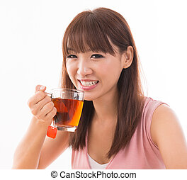 Asian female drinking tea - Young beautiful Asian female...