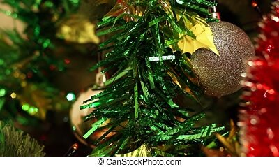 Christmas-tree decorations on background of the color lights