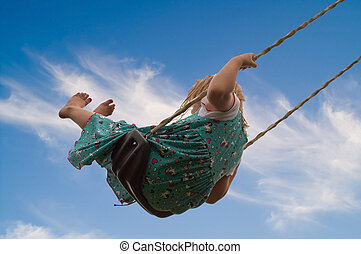 Little Girl on Swing - Pretty little blond girl on a swing...