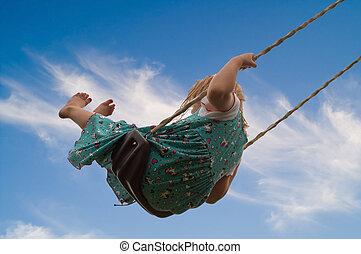 Little Girl on Swing - Pretty little blond girl on a swing...