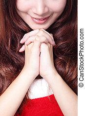 close up of Xmas girl praying - close up of beautiful...