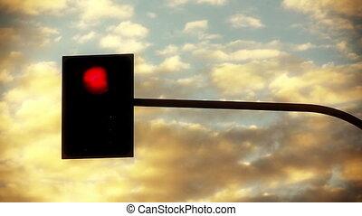 Traffic light against sky timelapse backgrounds