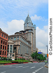 Shanghai Waitan district with historic buildings and street...