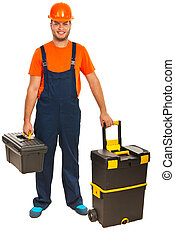 Craftsman with tool boxes - Full length of happy craftsman...