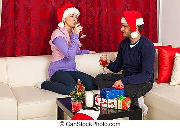 Xmas couple drinking wine - Couple celebrating with wine...