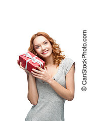 young red-haired happy smiling girl holding gift - young...