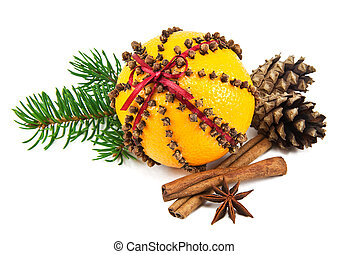Christmas clove and orange pomander with spices, pine cones...