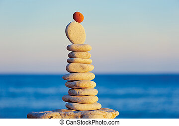 Equilibrium - Stack of pebbles. Balancing on the seashore