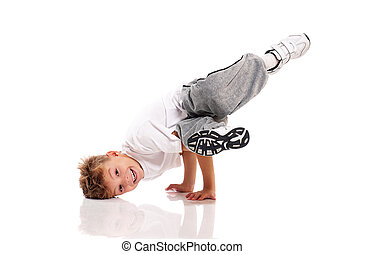 Boy dancing - Happy little boy dancing isolated on white...