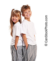 Happy children - Happy boy and little girl standing back to...
