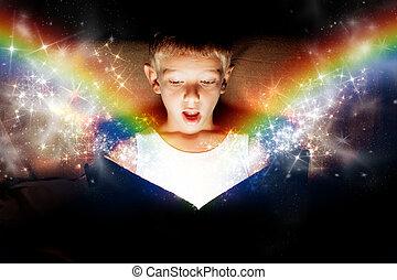 Magic book - A little boy opening a magic book. Concept that...