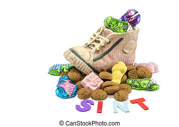 childrens shoe with pepernoten and other candy as chocolade...