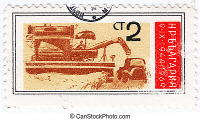 BULGARIA - CIRCA 1969 : stamp printed in Bulgaria shows a grain harvester combine in harvest time, circa 1969