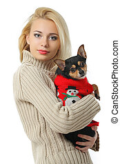 Beautiful young blond girl with cute yorkshire terrier dog,...