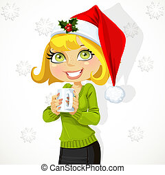 Cute girl in Santa hat hold cup of hot drink