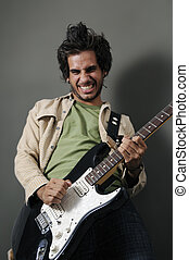 Guitarrist - Portrait of young guitarrist with funny...