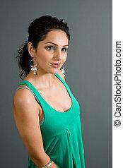 latina looking up - a young attractive hispanic / latina...