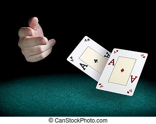 Flying aces - A mans hand throwing two aces over a green...