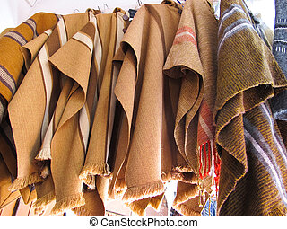 Andean ponchos in a traditional product market. Chile,