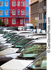 Line of Cars on the city street Bright houses as a...
