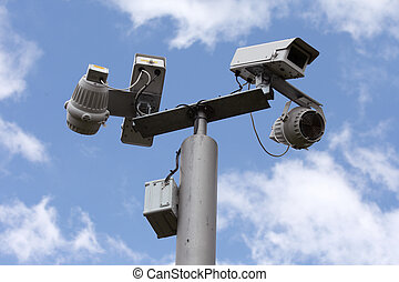 Security cameras watching over us on a sunny day