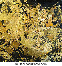 Gold leaf on black background