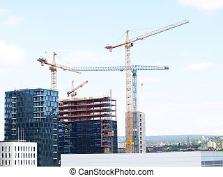Construction site overview in a city, towards blue sky