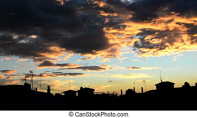 Sunrise and siluete of the city - Sunrise, clouds moving and...
