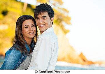 Handsome young couple at seaside - Close up portrait of...