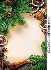 Frame with vintage paper and Christmas tree branches on...