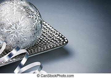 Festive Christmas decoration over silver background