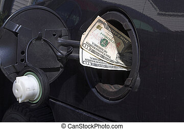Gas Money - Pouring money in to the gas tank - the high cost...