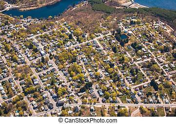 Aerial view of suburban Clinton, Massachusetts and water