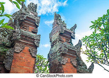 Bali temple gate - Split brickwork marking doorway to a...