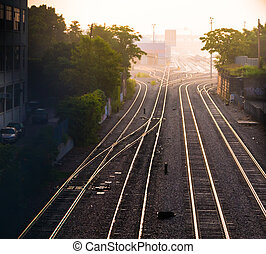 Train tracks and freight yard - Train tracks at dawn in...