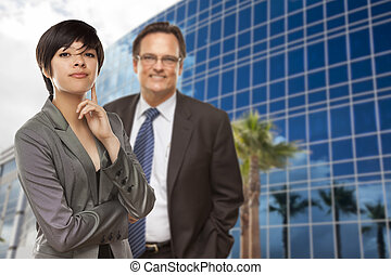 Mixed Race Woman and Businessman in Front of Building