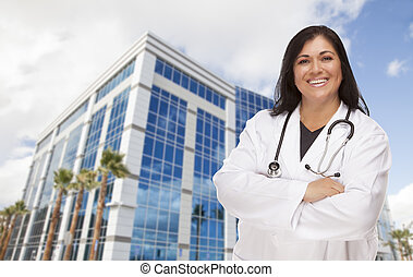 Attractive Hispanic Doctor or Nurse in Front of Building -...