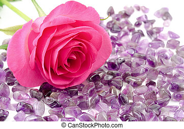 Rose and amethyst - Pink rose and amethyst rough stones on...