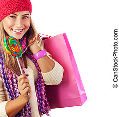 Pretty female with candy and paper bag - Picture of pretty...