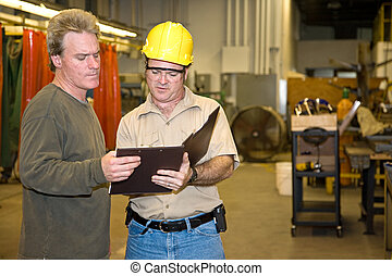 Auditor and Manager - Industrial auditor discussing his...