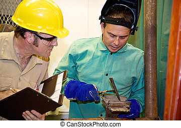 Welder and Supervisor - Welder hammering metal as an auditor...