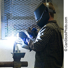 Welder at Work - Welder at work, illuminated by an acetylene...