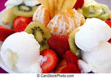 Fruit desert with cake and ice cream