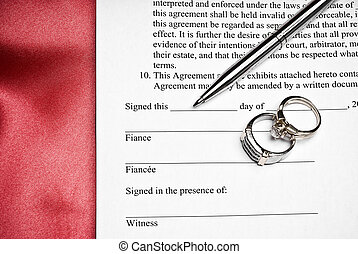 Prenuptial agreement - Prenutial agreement with a pen and...