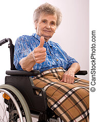 elderly woman in wheelchair - portrait of an elderly woman...