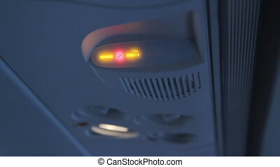No smoking In-Flight. - No smoking light warns passengers...