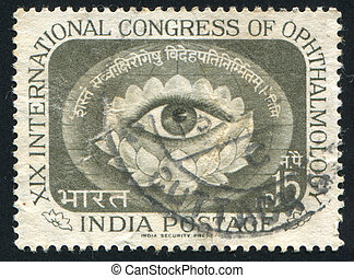 Eye within Lotus Blossom - INDIA - CIRCA 1962: stamp printed...