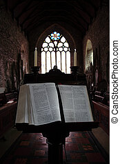 open bible 1 - a bible on a stand in the church