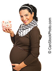 Happy pregnant woman with piggy bank - Happy casual pregnant...
