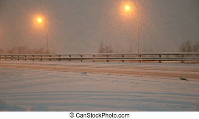 Winter highway. Snow, blizzard, car
